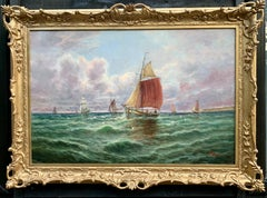 19th century Victorian English or Irish fishing boats with landscape at sea