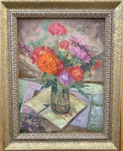 Still life of Red and Orange Flowers in a glass vase on a table