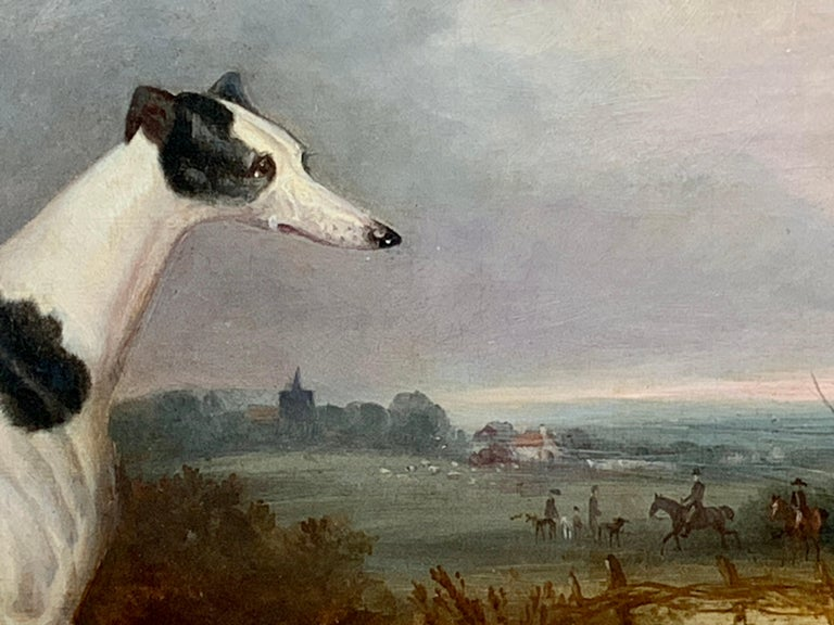 Outstanding Early 19th-century portrait of a grayhound in an extensive landscape with a hunt in the distance.  This piece has all the qualities of the early 19th-century sporting painters such as John Ferneley, J.F.Herring and others. The dog is
