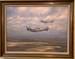 Two British Spitfires flying over the English landscape, 20th century
