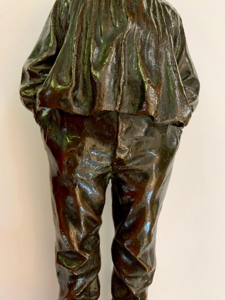 An amazing bronze cast of a little 19th-century boy. The quality of the piece is outstanding, as is the color and patination. There is little known about the painter other than he worked in clay and Bronze during the latter part of the 19th century.