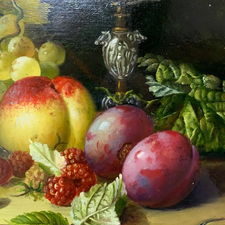 Very decorative late 20th century still life of fruit and a silver dish on a table. Whilst the subject is classic the artist has painted a crisp, fresh composition. The quality of the piece is outstanding.   The artist has a great skill in painting