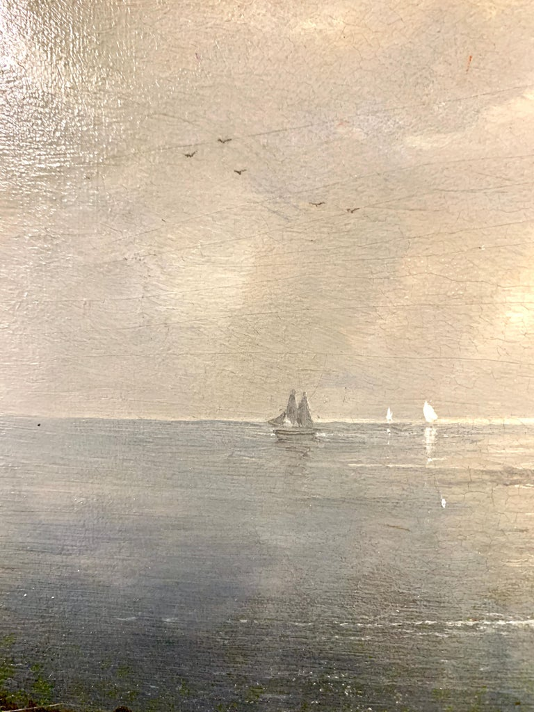 Night time sea scape with landscape and moonlight, with fishing boats at sea. - Victorian Painting by Karl Heilmayer