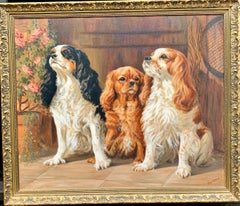 20th century English oil Portrait of three King Charles Cavalier Spaniels.