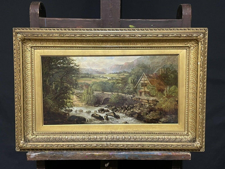 SIGNED VICTORIAN FRAMED OIL PAINTING - MOUNTAINOUS RIVER LANDSCAPE WITH FIGURES - Victorian Painting by Victorian signed