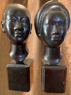 Two bronze busts of girls