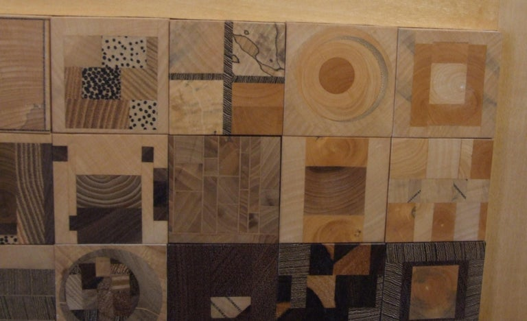 Marquetry made of many different kind of wood as  listed by the artist, Jean-Luc Merigot, on the back of the panel.