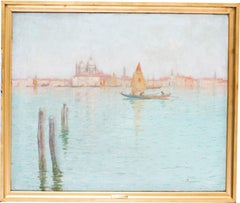 An early 20th Century oil painting of boats on the blue lagoon in Venice