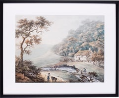 Figures before a cottage in a hilly woodland landscape