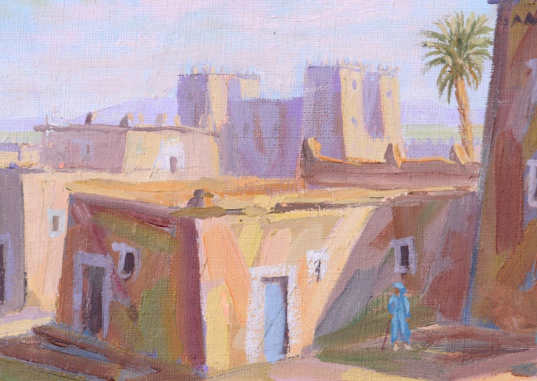 Middle Eastern street scene by Boukhari (20th century). Signed and dated in both English and Arabic. Presented in a gold painted frame with a wide liner. Image size: 7.5