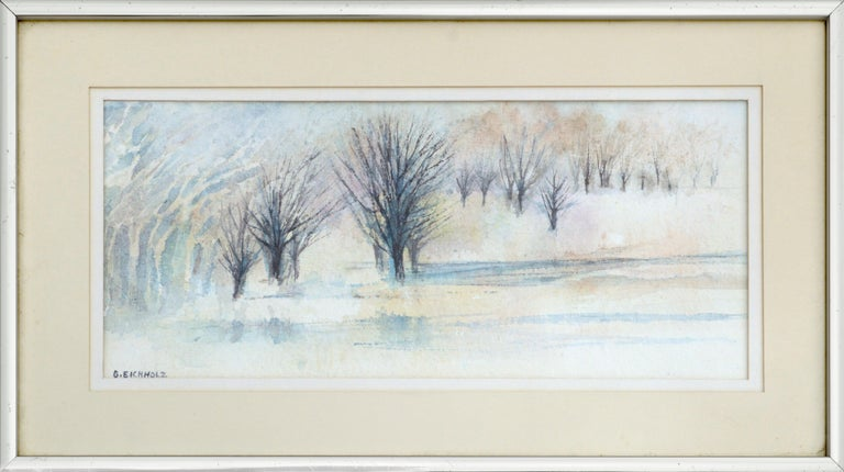 """Serene winter landscape by Grace Eichholz (American, b. 1927). Signed """"G. EICHHOLZ"""" in the lower left corner. Artist info and title on verso. Presented in a double mat of cream and white with a silver frame and glass. Image size: approx. 6.5""""H x"""