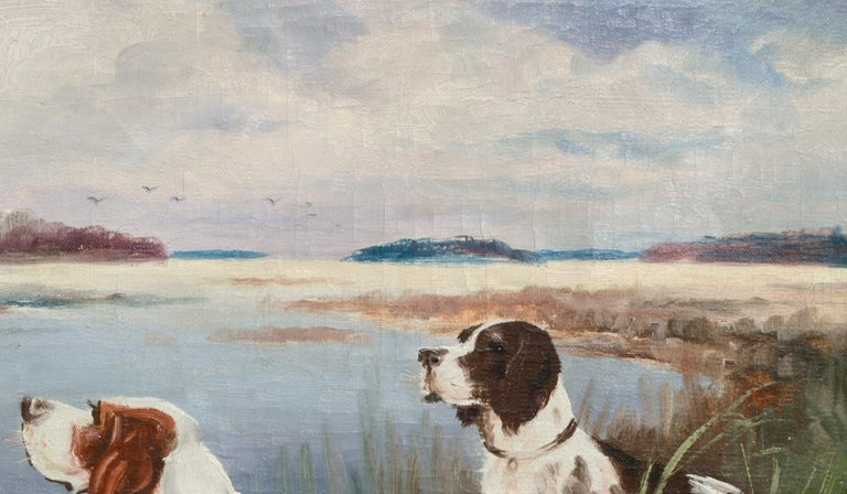 Two hunting dogs near a lake by Nikolai Silverberg (Silfverberg) (Finnish, 1899-1977). Signed in the lower left corner. Presented in a gildwood frame. Image size: 17