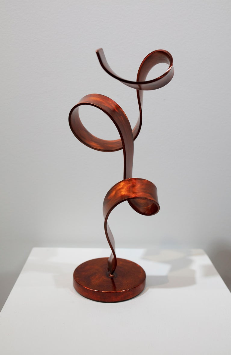 Orange Swirl is a tabletop sculpture made out of steel with an orange dye and clear coat.   Connecticut sculptor Joe Sorge says about his work,