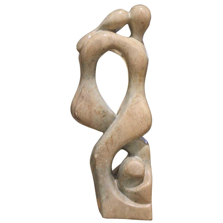 Jose Zacarias Figurative Sculpture - Peach Toned Stone of Two Embracing Figures