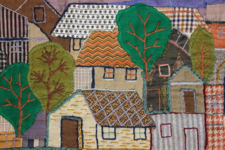 Tapestry of a town with a harbor full of boats. The tapestry is from Martha Mood's illustrated book. It is signed by her. Tapestry is not framed.  Artist Biography:  Martha Mood, artist, photographer, and teacher, was born in Oakland, California, on