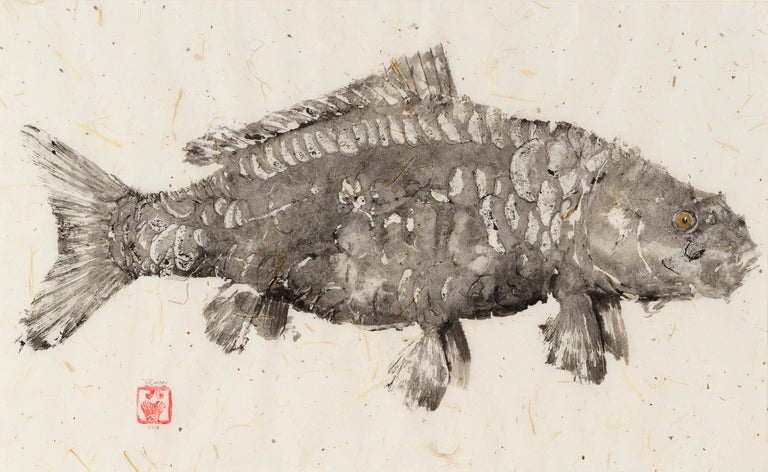 This is a Gyotaku method painting of two fish on a mulberry paper background.  This fish impression using minimal color is akin to a fossil.  The mulberry paper has a soft hue and slightly wavy texture adding the overall feel of the artwork.  The