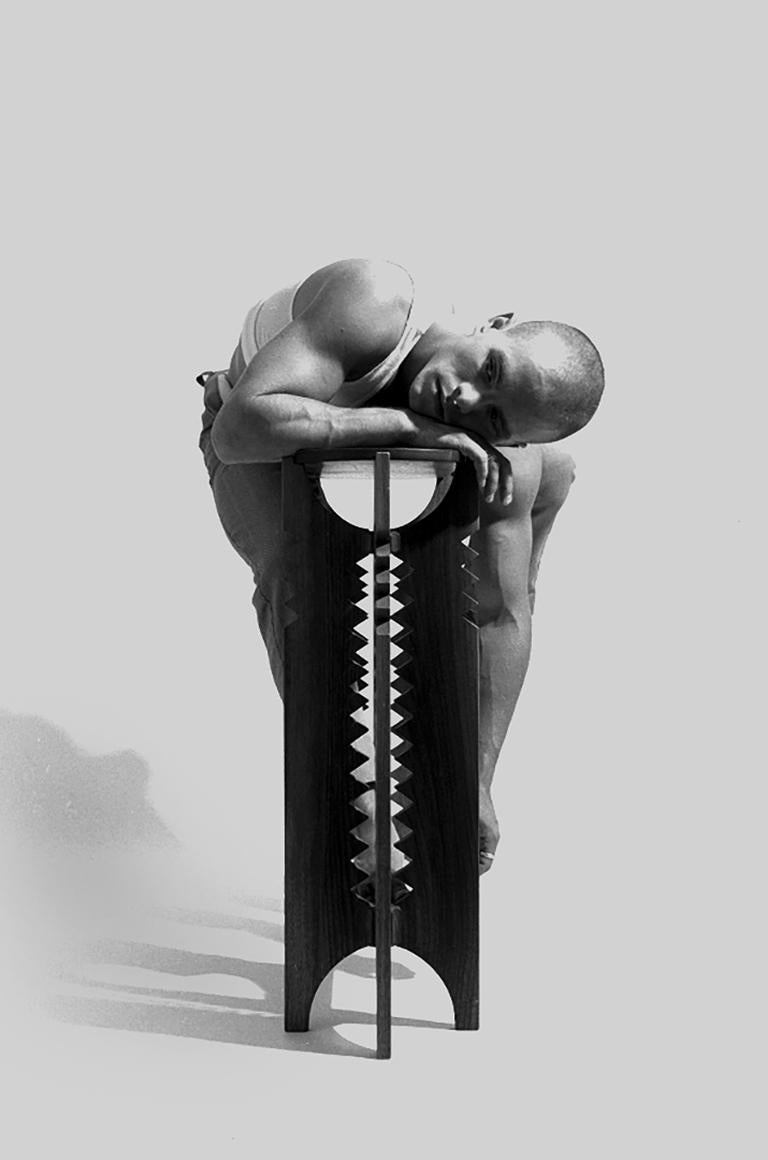 Untitled (Brian on Console Table) - Contorted Nude, Black and White Photograph