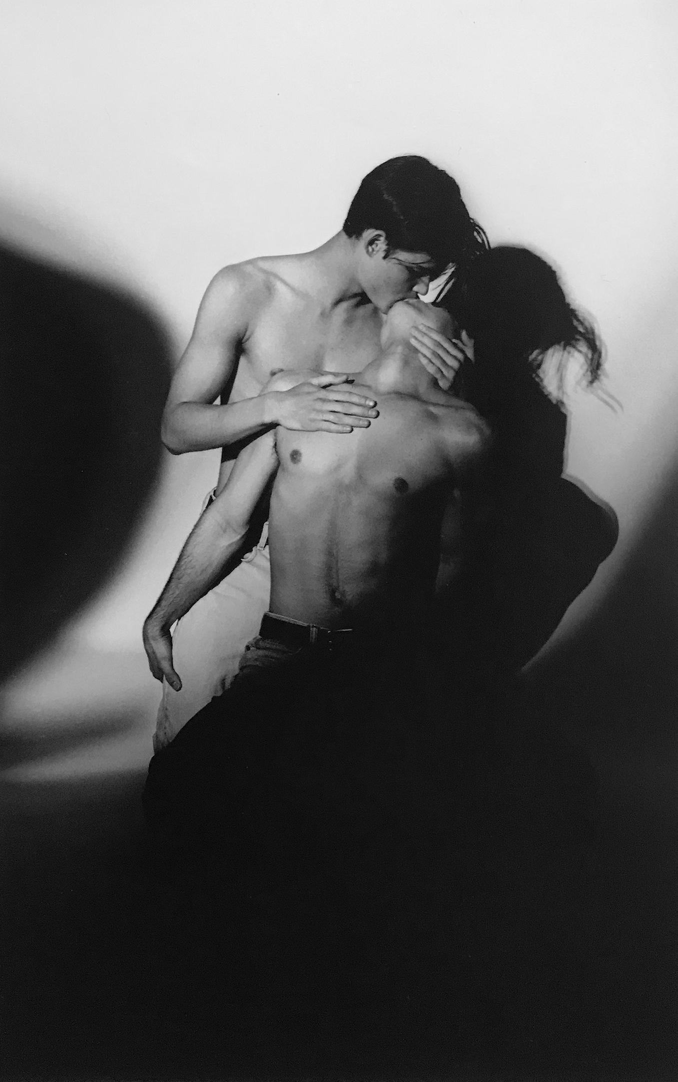 Male Bonding - Passionate Kiss with Dramatic Shadow, Black and White Photograph