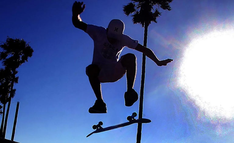 Chris Martinez Color Photograph - Skateboarder, Palms and Sun