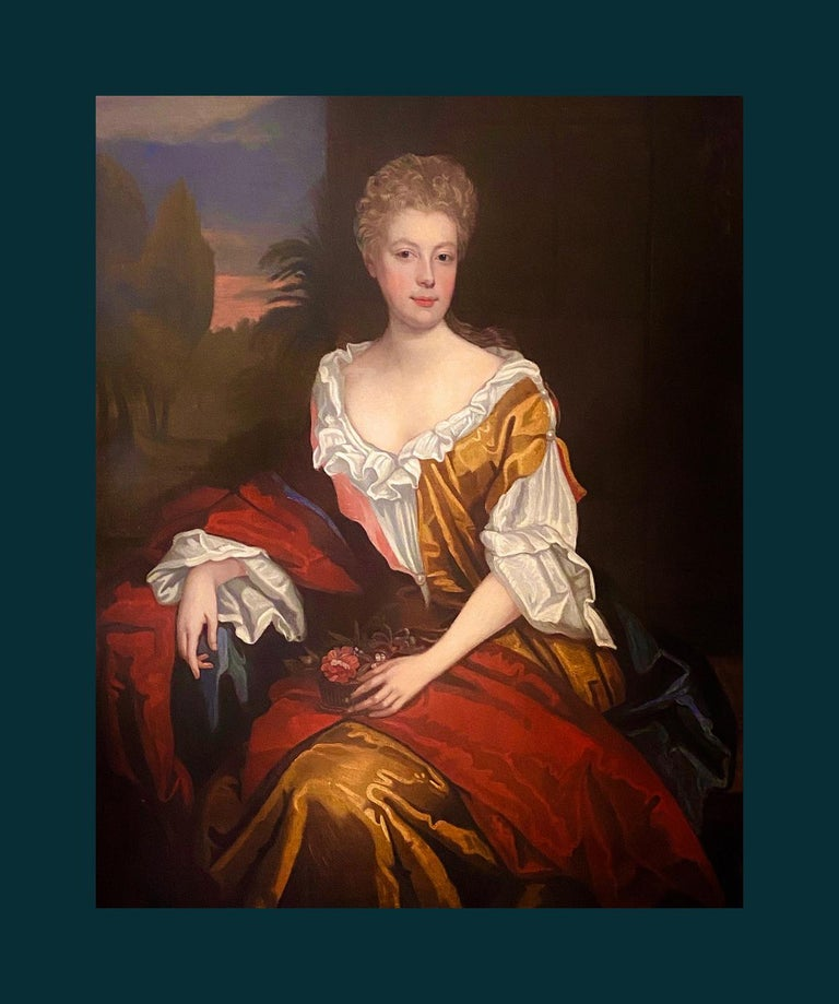 ENGLISH SCHOOL PORTRAIT OF LADY MORGAN c.1700  -  FOLLOWER OF WILLIAM WISSING   A richly coloured high Baroque portrait of a lady in flamboyantly coloured dress sitting in the shade of a stone building. One hand rests delicately on a basket of
