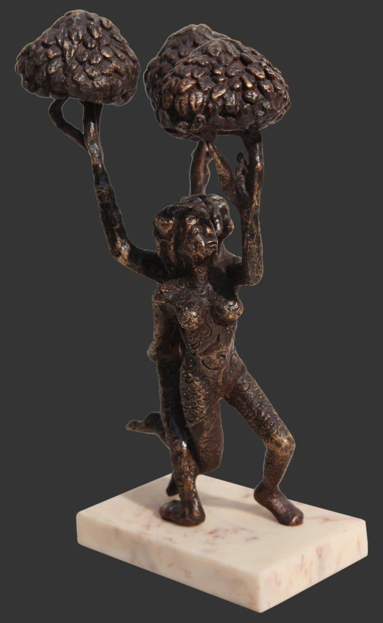 Seema Kohli - Untitled - H 8.5 x L 5.5 x W 4.5 inches Small Bronze sculpture.  The Meticulous artist depicts the tree of life in her bronze small work.  This could look beautiful in your study Table or perched on your various interesting Coffee