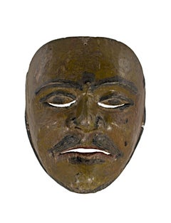 Indonesian Wooden Mask of a Western Character