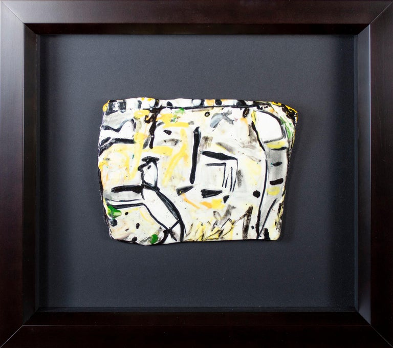 This small plaque is an intimate and exciting example of the ceramic work of Estherly Allen. She was a student of George McNeil, an important Abstract Expressionist, and this Expressionist influence is visible in this experimental work. In the