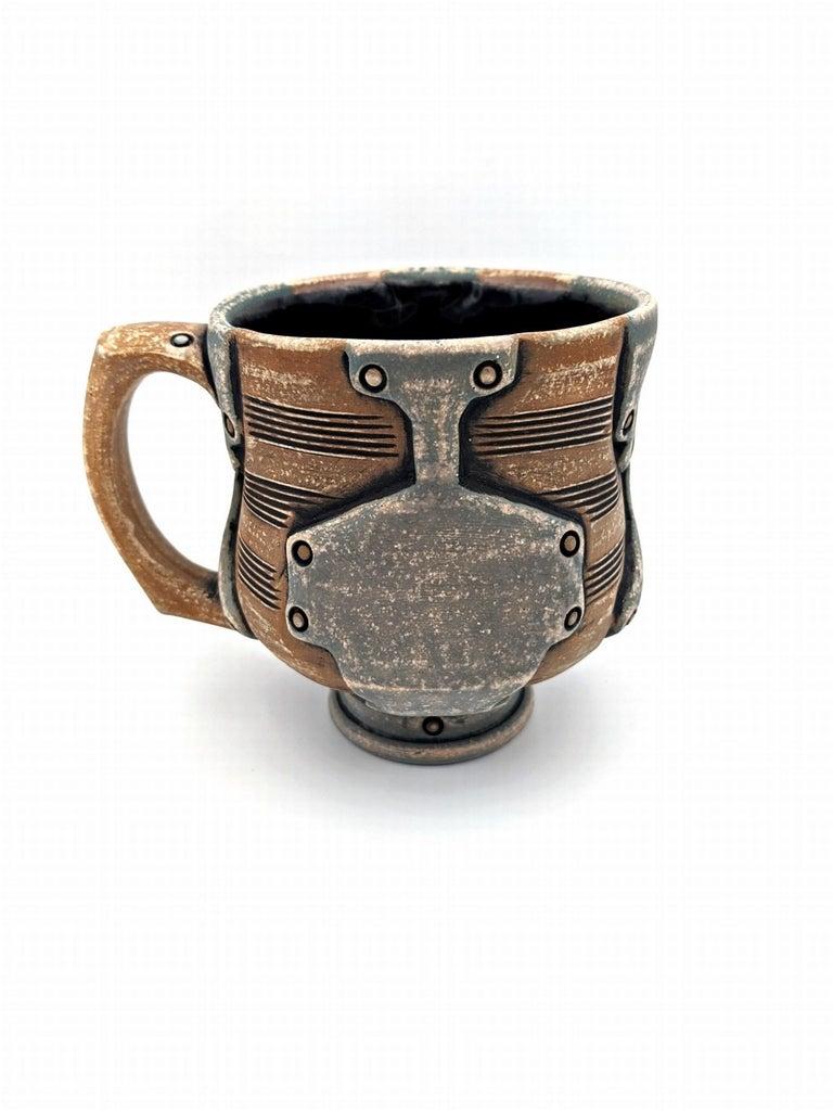 Artist : Andrew Clark Title : Coffee Mug Materials : Stoneware, underglaze, terra sigillata, glaze, cone 6 Date : 11/19/2019 Dimensions : 3.5 x 4.5 in.  Andrew Clark explores his interest in machinery and engineering through ceramics. Influenced by