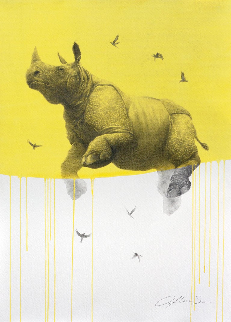 """""""Jouney No. 5 Yellow Rhino"""" by Oliver Flores is a whimsical watercolor and charcoal drawing of a flying rhinoceros and flock of birds.  This artwork comes in a white floater frame, ready to hang. Framed dimensions are : 31.5"""" h x 23.5"""" w inches / 80"""