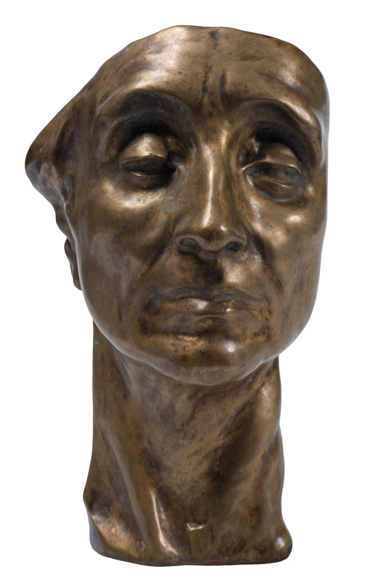 Head of Man is an original artwork realized by Amedeo Bocchi in 1920 ca.  This little sculpture is made in gilded bronze.  The original wax model is published on the artist's monography edited by L. Ragghianti, Ed. De Luca.  This object is shipped