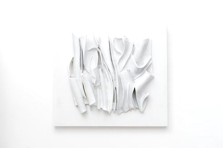 White Cosmic Folds (Pieghe Cosmiche Bianche) is a beautiful contemporary artwork composed by ceramic and enamel on panel realized in 2017 by the Italian artist, Michele Cossyro.   In excellent condition, this contemporary artwork is created after an