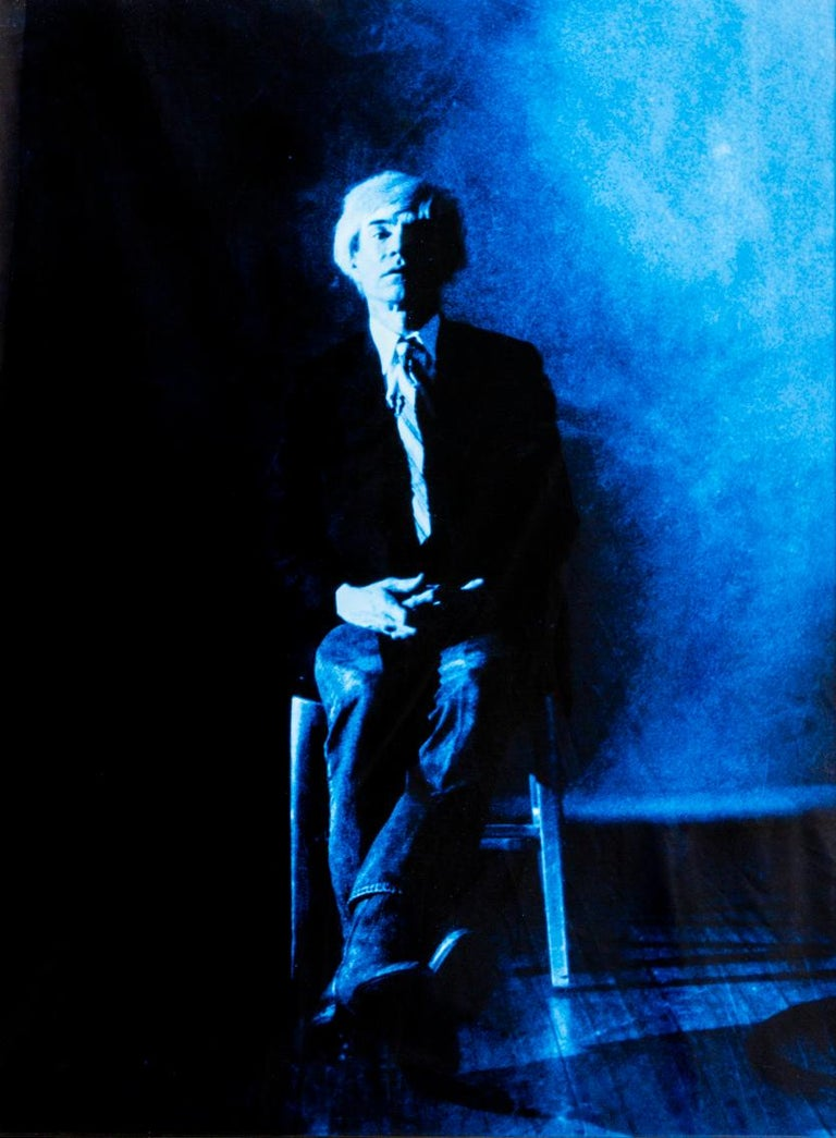Portrait of Andy Warhol posing - Blue print-toning by G. Bruneau - 1980s - Photograph by Gerald Bruneau