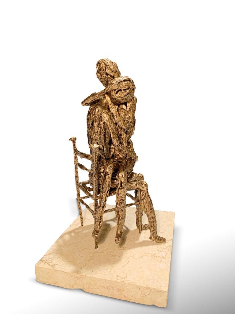 Tenderness is an original metallic sculpture realized by the Italian artist Fero Carletti in 2020.  Original title: Tendresse.   The sculpture is made out of small pieces of original WWII relics like bomb shells, shrapnels, bullets.  Ferruccio
