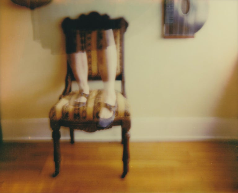 Lisa Toboz Color Photograph - Balancing Act - Contemporary, Woman, Polaroid, Photograph, 21st Century