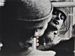 Woman Reflecting in the Window