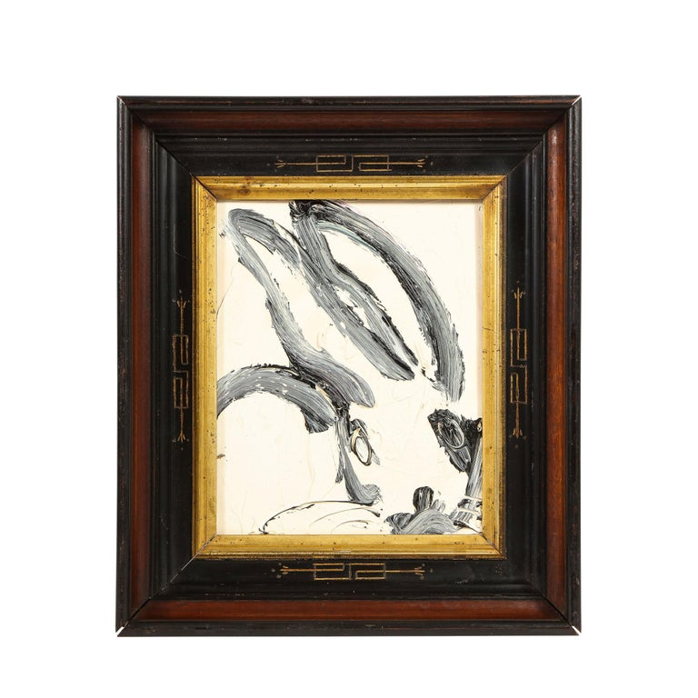 This whimsical and sophisticated painting was realized by the esteemed contemporary painter, Hunt Slonem in 2013. It presents a stylized bunny rabbit, rendered with loose and expressive brush strokes in black and white paint. Bold, graphic and