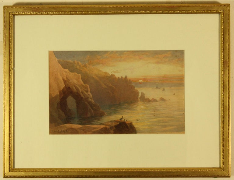 Gamper Arch, The Lands End and Longships Lighthouse by Thomas Hart FSA Image Size 6.75 ins by 10.75 ins Overall Frame Size  14 ins by 18.25 ins  Thomas Hart  Born 1830 Crowan Cornwall, Died 1916 The Lizard, Cornwall Thomas was a prolific painter in