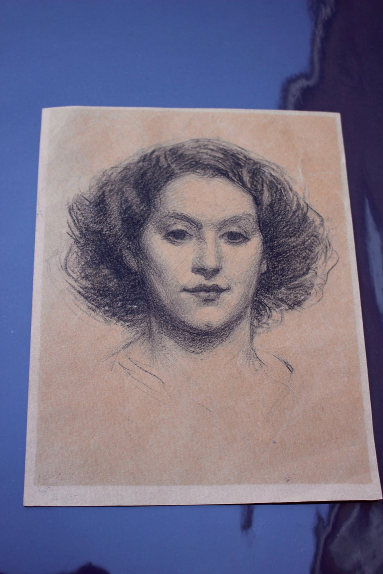 A well executed charcoal drawing of a young woman, circle of Augustus John. 9' x 7
