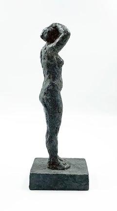 She Turns to Face the Sun - contemporary figurative bronze sculpture