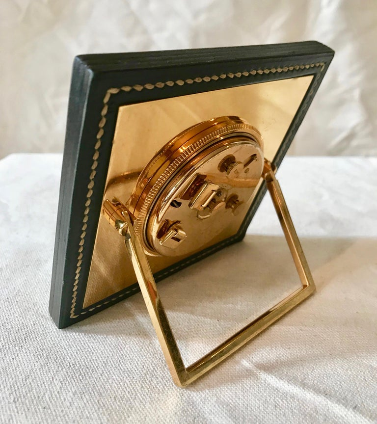 This is a rare find of an original Hermes alarm clock in overall great condition having been made in the 1950's. The leather, stitching and edging have developed an amazing patina that only time could bring. The gold plated back has some minor