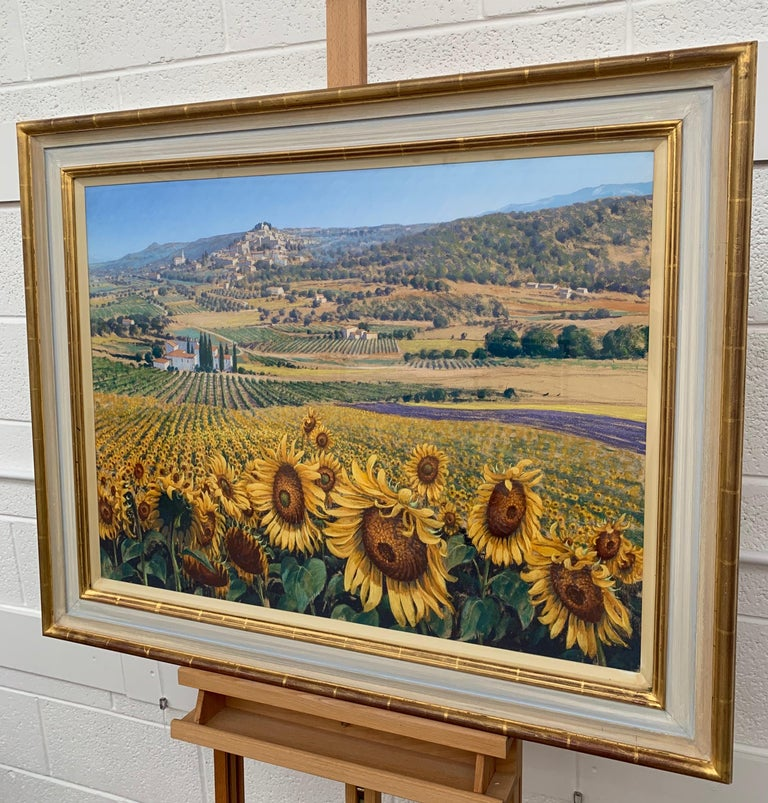Sunflowers in Bonnieux Provence France Landscape by British 20th Century Artist Lionel Aggett (1938-2009). Signed front and rear, framed behind glass in a high quality gold and cream shabby chic moulding.   Art measures 32 x 24 inches Frame measures