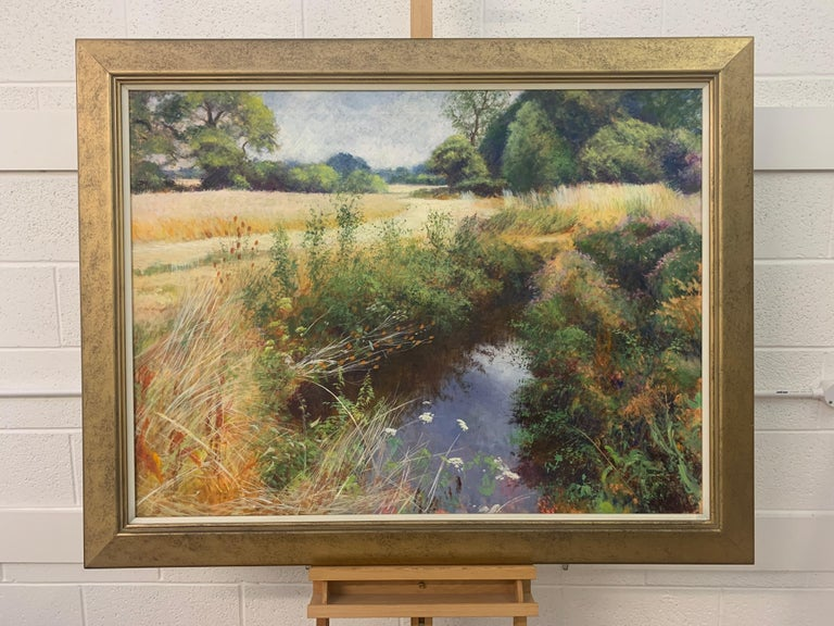 English High Summer Riverbank Landscape Original Oil Painting by Artist Graham Painter (British 20th Century, 1947-2007). Country Stream, Oil on Canvas, framed in a high quality gold moulding.  Art measures 49.5 x 35.5 inches Frame measures 57 x 43