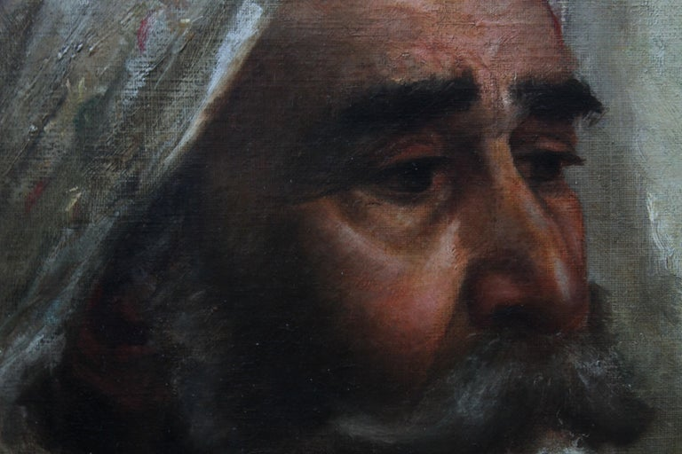 This striking Orientalist oil portrait painting is by a talented Turkish School artist from the 19th century. The portrait is an extremely well painted and detailed realist oil painting of the head and shoulders of an Arab man wearing a white