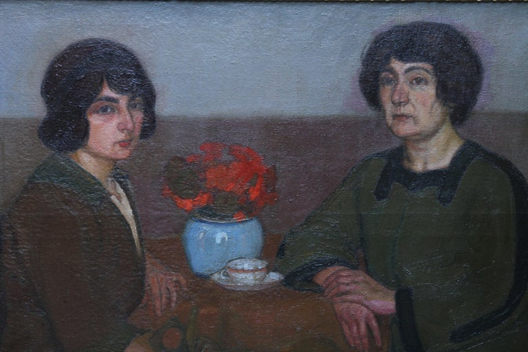 This interesting exhibited Post Impressionist portrait oil painting is by artist L Capelle. The painting is signed and dated 1913. The painting has had various titles in its history; two women with a vase of red flowers and mother and daughter