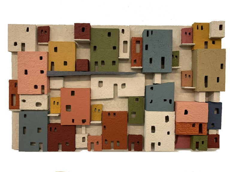 This outstanding piece was done to represent lively towns around Mexico. It´s 3D formation gives spaces unique contrasts and the color palette was done specifically to bring emotion to spaces. It is unique and elegant. Easy to mount for it has metal