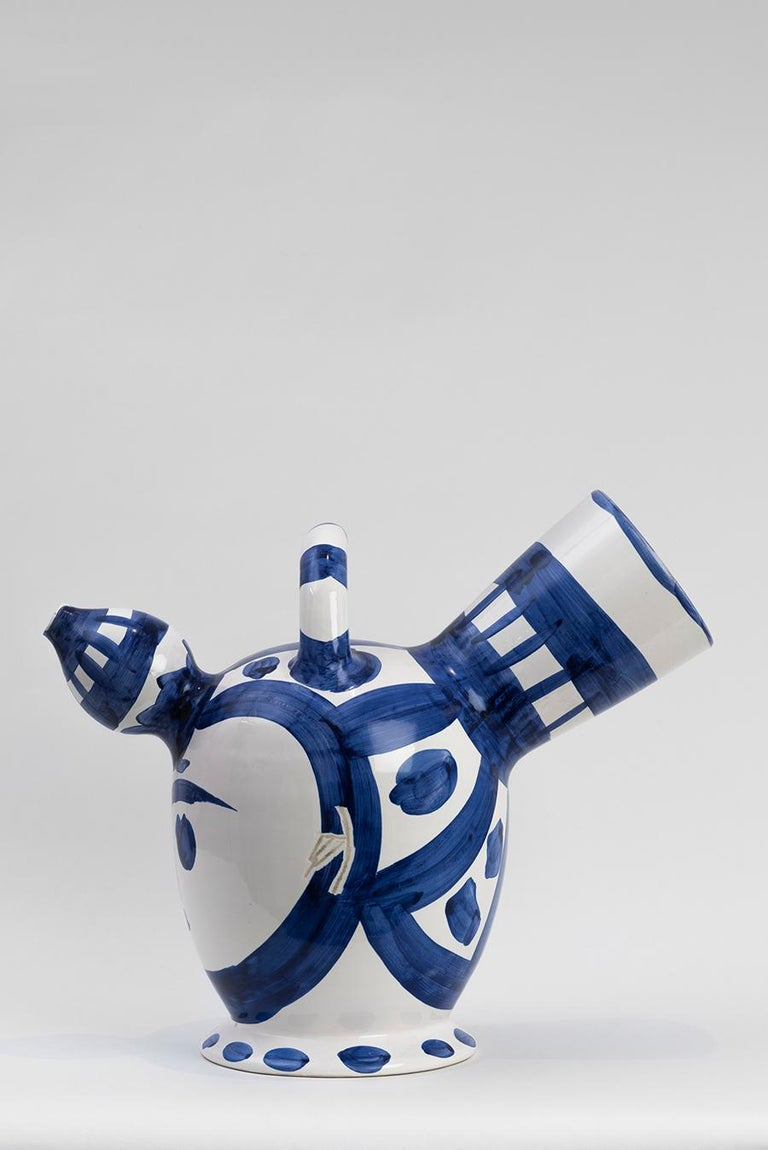 Turned Pitcher (A.R. 142) Inscribed with 'Edition Picasso' and 'Madoura', numbered 51/100 and stamped 'Edition Picasso / Madoura Plein Feu' on the base White earthenware clay, decoration in oxides, engraved on white enamel under glaze Executed in an