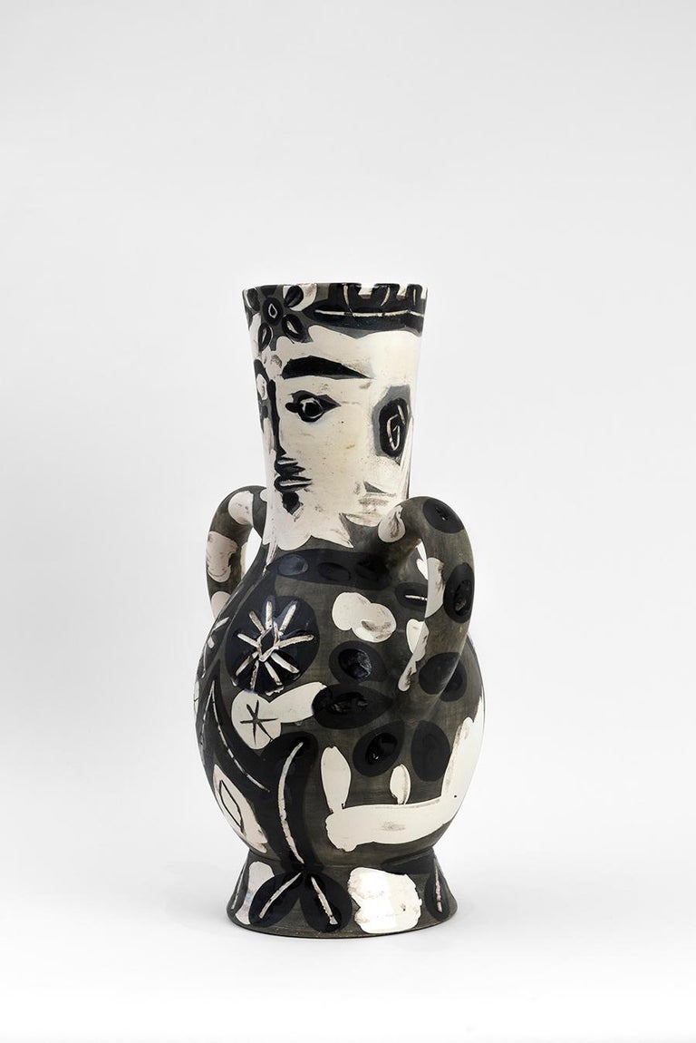 Turned vase (A.R. 141) Stamped 'Edition Picasso / Madoura' on base White earthenware clay, engobe decoration, engraved under partial brushed glazed  With subjects varying from Greek mythological figures, animals, faces and even scenes of the Spanish