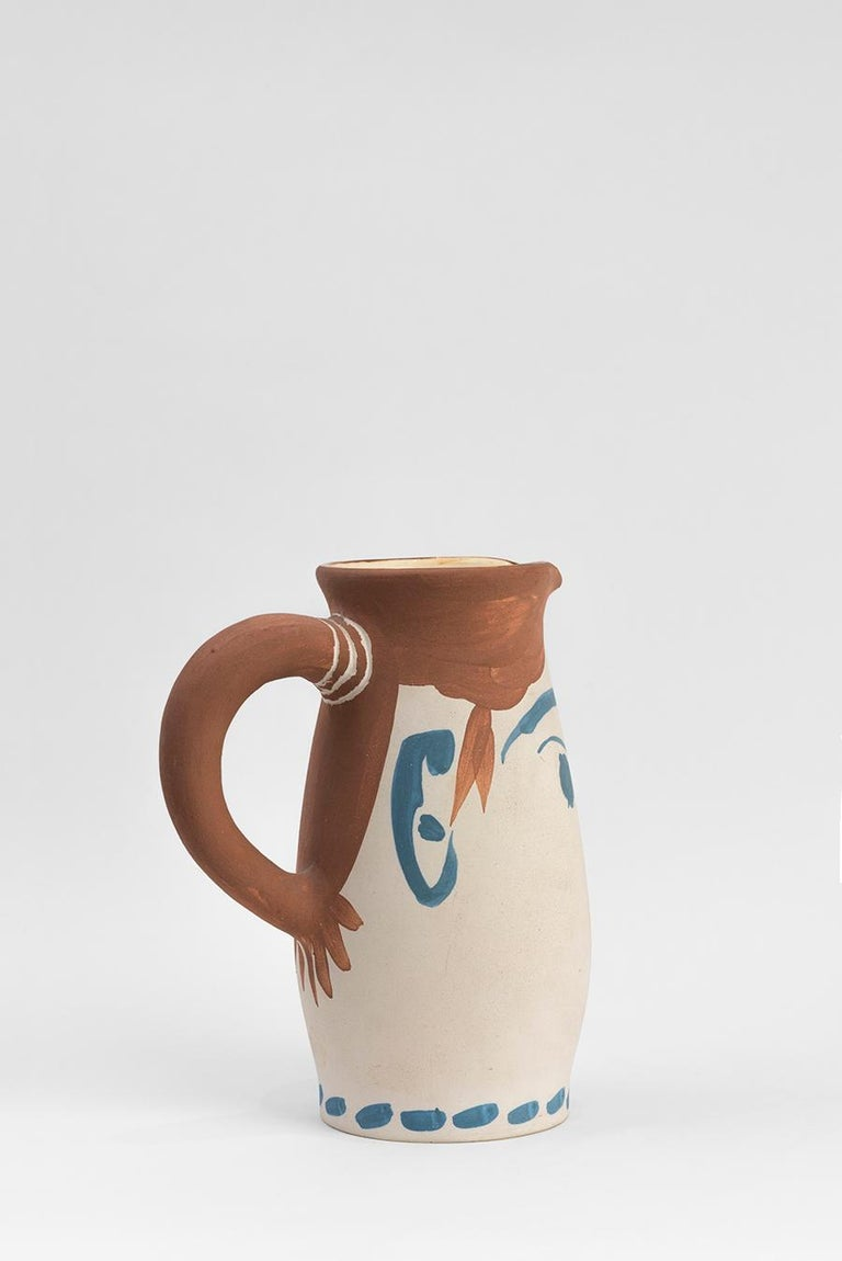 Turned pitcher (A.R. 434) Inscribed 'Edition Picasso' and 'Madoura', numbered 218/300 and stamped 'Edition Picasso / Madoura Plein Feu' on base White earthenware clay, decoration in oxide on white enamel Executed in an edition of 300  With subjects