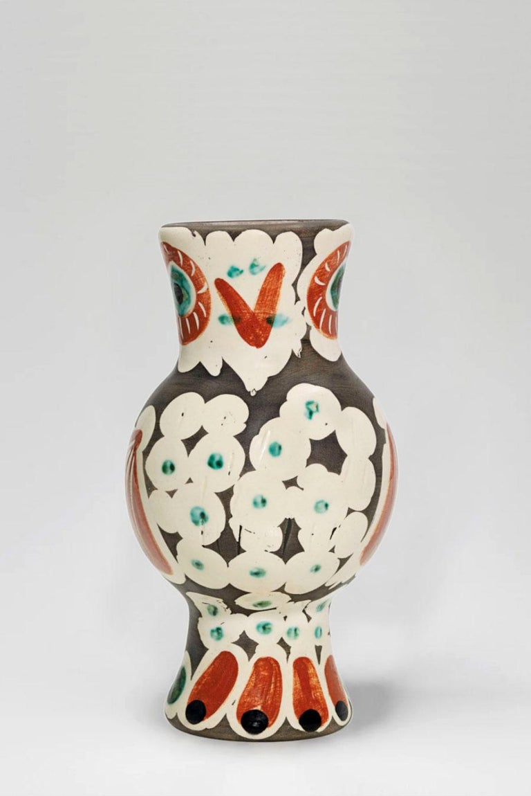 Turned vase (A.R. 543) Numbered and stamped 'Madoura Plain Feu / Edition Picasso' on base White earthenware clay, decoration in engobes under partial brushed glaze Red, green, white, black Height: 11 inches Executed in an edition of 500  With