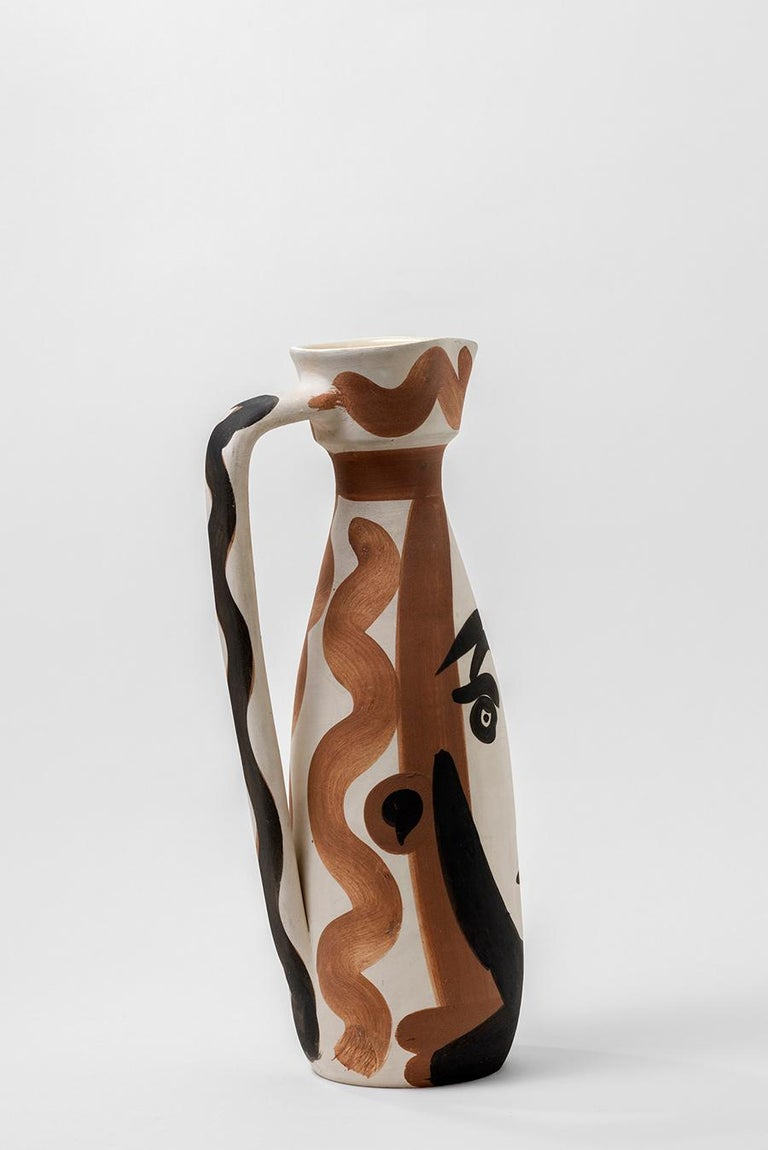 Turned pitcher (A.R. 288) Inscribed 'Edition Picasso' and 'Madoura' and stamped 'Madoura Plein Feu / Edition Picasso' on base White earthenware clay, decoration in engobes and glaze Red, black Height: 12 1/4 inches Executed in an edition of
